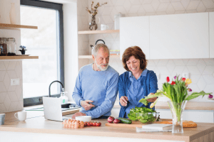 Couple cooking healthy dinner together at home