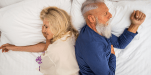 Happy senior couple going to sleep