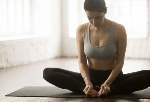 Woman doing butterfly pose
