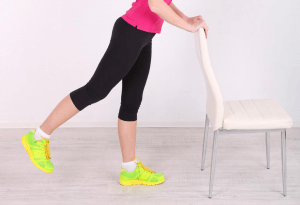 Woman doing standing hip exercise
