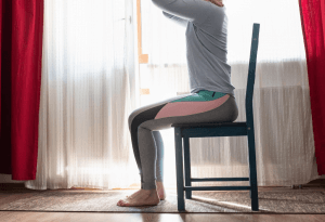 Woman doing seated hip exercise