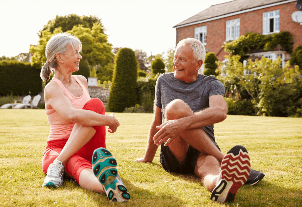 Healthy senior couple stretching outdoors