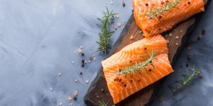 Raw Salmon with Seasoning on Wood Board