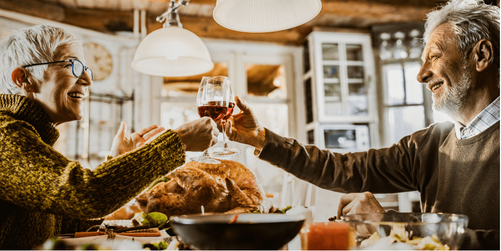 Couple toasting at Thanksgiving dinner