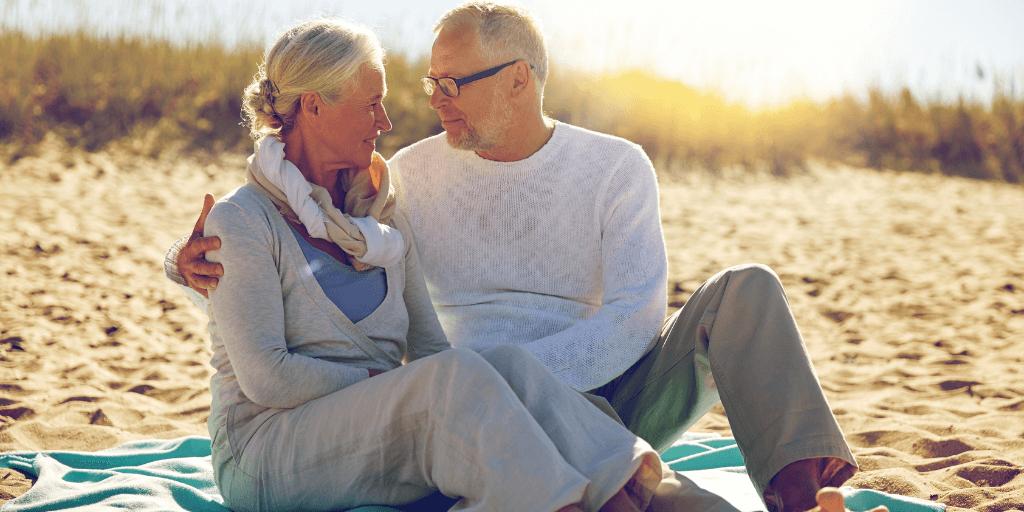 Happy Senior Couple Relaxing on Beach