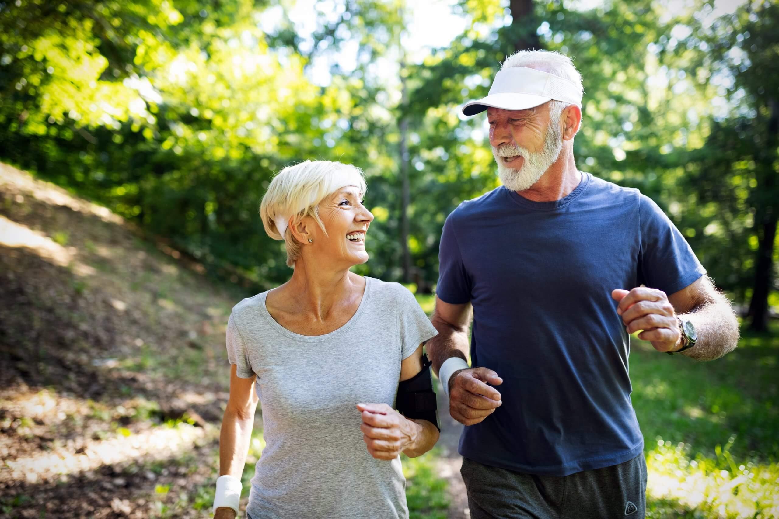 Healthy senior couple outside walking