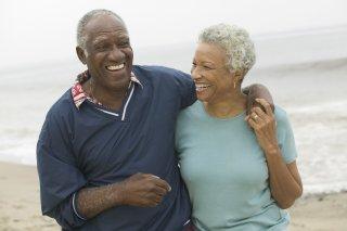 Healthy senior couple walking on the beach