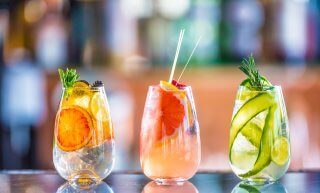 Three refreshing summer beverages on bar