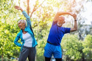 Active Senior Couple Stretching