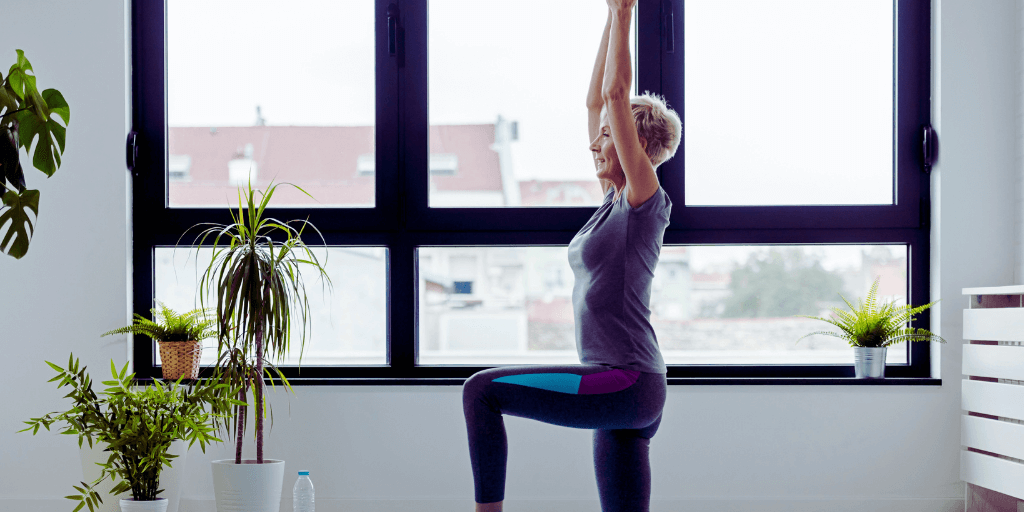 Healthy senior woman doing yoga at home